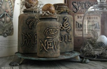 Witch's potion bottles from tin cans and plastic medicine bottles